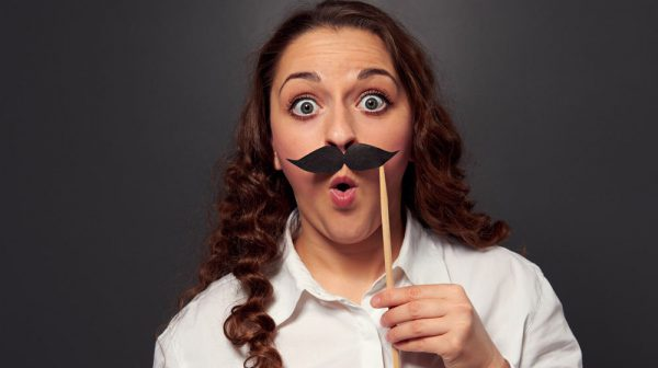 Девушка с усами на палочке