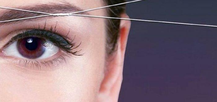 Удаление волос ниткой на лице