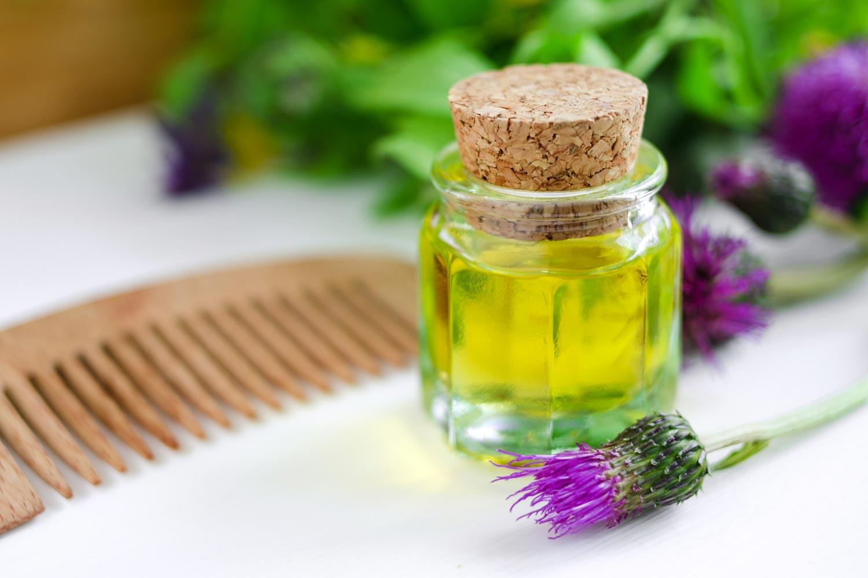 Репейное масло: применение в уходе за волосами