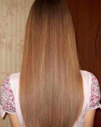 Волосы девушки, которая использует для ухода за шевелюрой масло авокадо