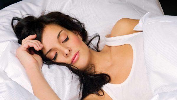 Спящая женщика