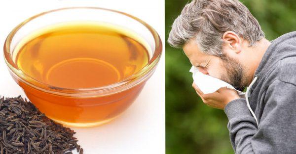Мужчина чихает, масло и семена тмина