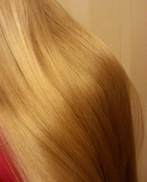 Волосы девушки после использования оливкового масла